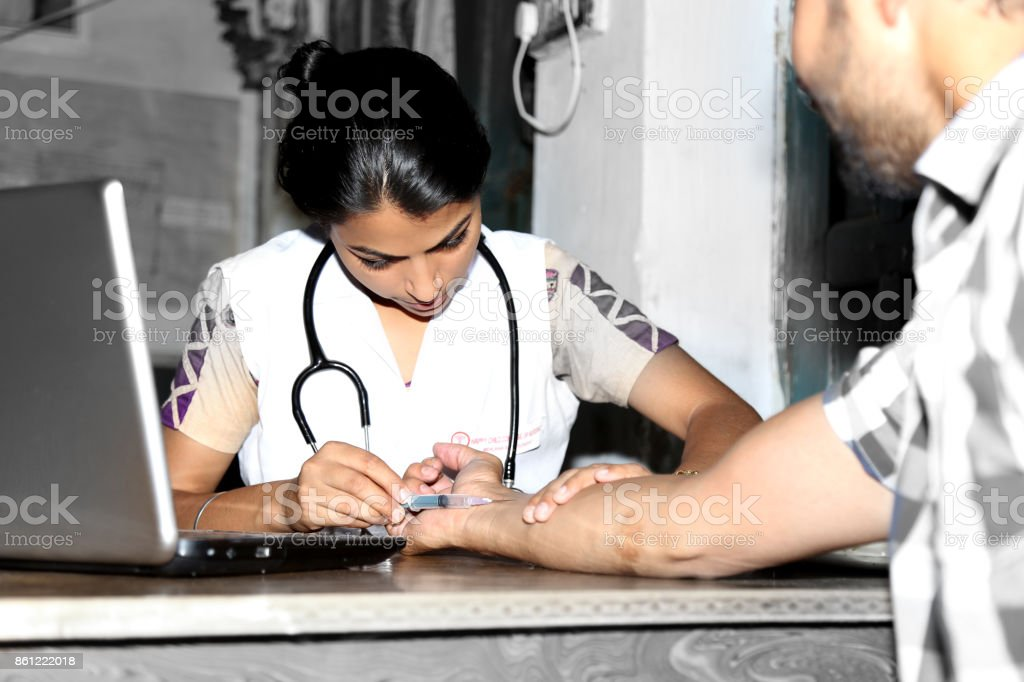 Doctor giving injection to the patient stock photo