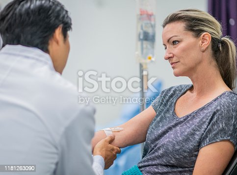 852092658istockphoto Doctor Giving IV Treatment to Patient stock photo 1181263090