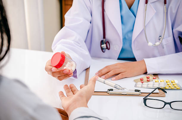 doctor giving medicine to patient stock photo