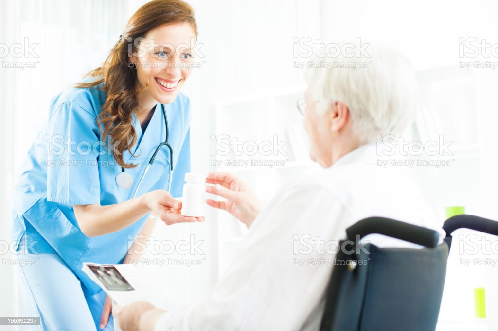 Doctor Giving Medicine to Senior Woman. royalty-free stock photo