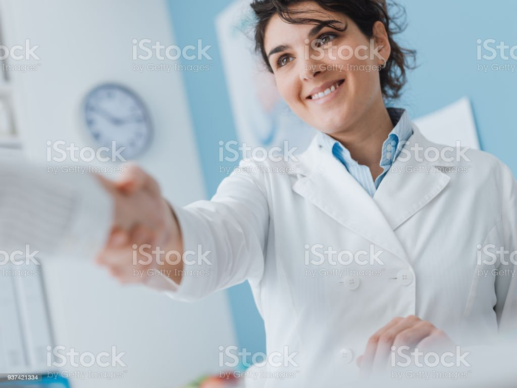 Doctor greeting a patient stock photo
