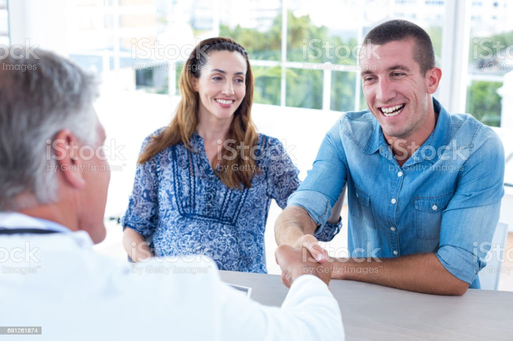 Doctor greeting future parents stock photo