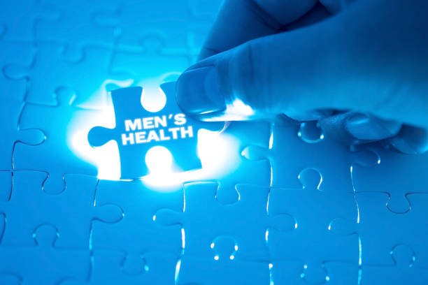 Doctor hand holding a jigsaw puzzle with men's health word. Concept Healthy. stock photo