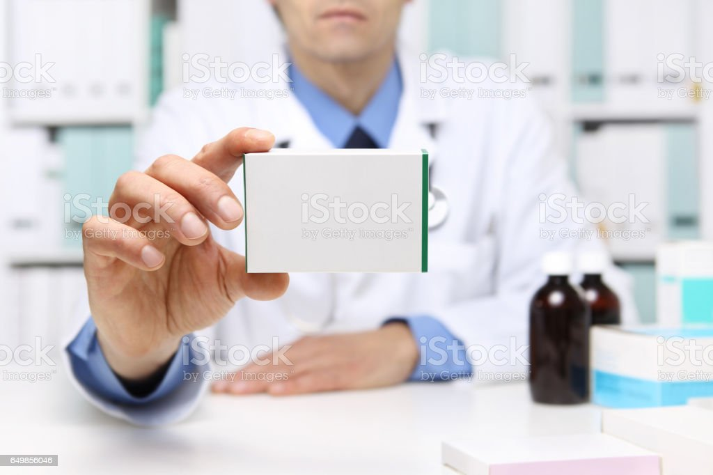 Doctor hand showing drug boxes at Office Desktop. Health care, Medical and Pharmacy Concept. stock photo