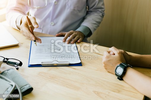 873418972istockphoto Doctor hand talking to the patient about medication and treatment. 922763688