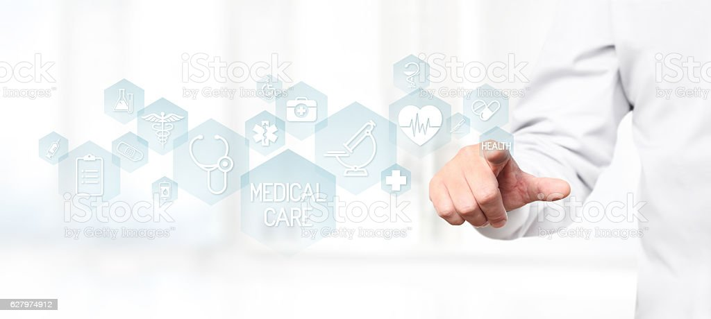 Doctor hand touching medical icons on virtual screen stock photo