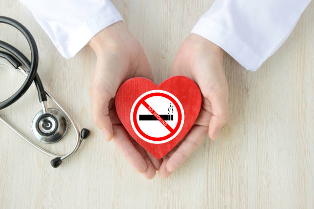 Doctor having heart object with no smoking sticker stock photo