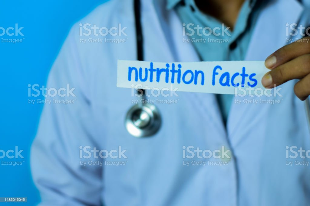 Doctor Holding A Card With Text Nutrition Facts Stock Photo Download Image Now Istock
