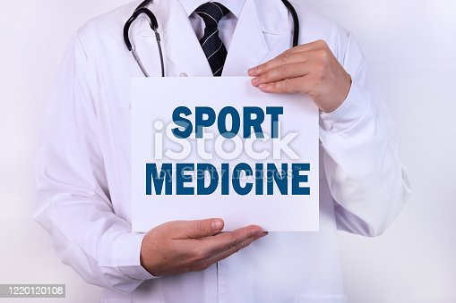 1092248526 istock photo Doctor holding a card with text Sport medicine, medical concept. 1220120108