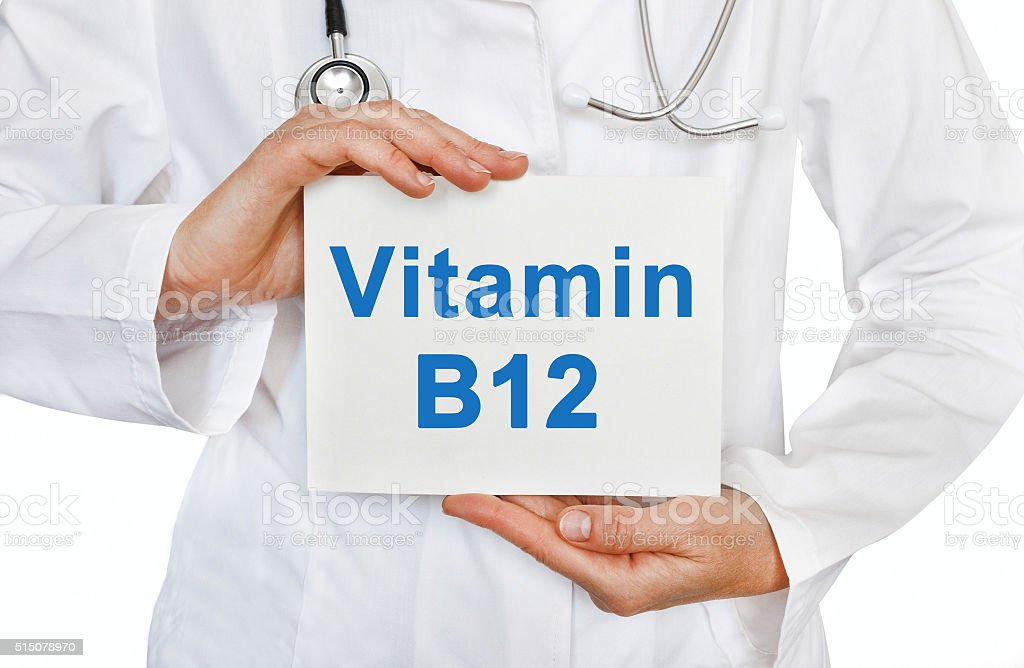 Doctor holding a card with Vitamin B12, Medical concept stock photo