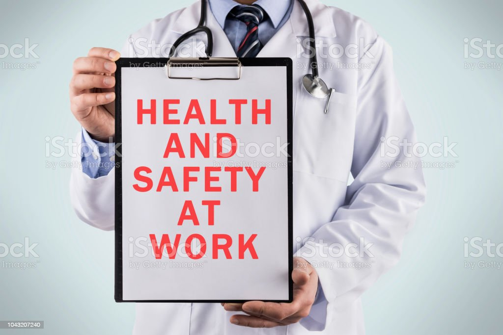Doctor holding a clipboard with Health and safety at work, Medical...