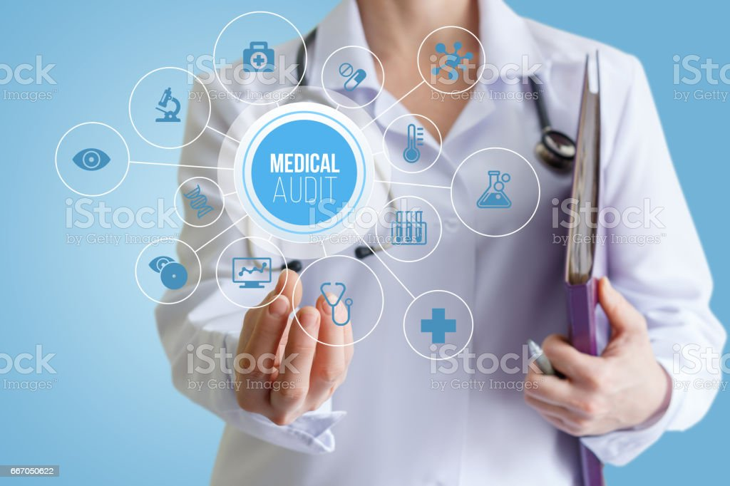 Doctor holding a medical audit. stock photo