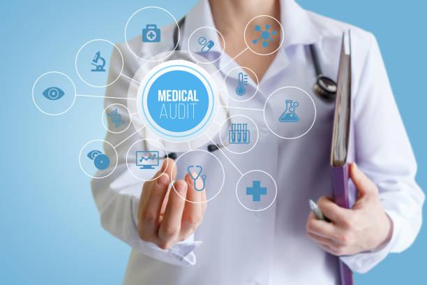 Doctor holding a medical audit. - foto stock