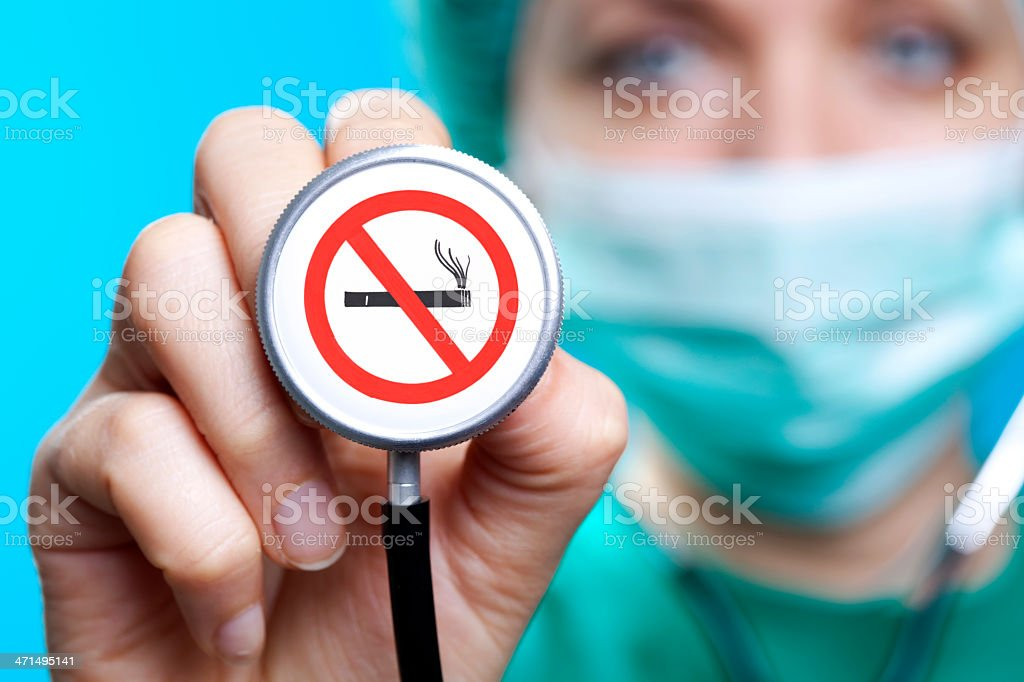 Doctor holding a no smoking sign on his stethoscope stock photo