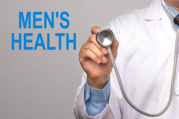 Doctor holding a stethoscope with men's health word on gray background. Concept Health. stock photo