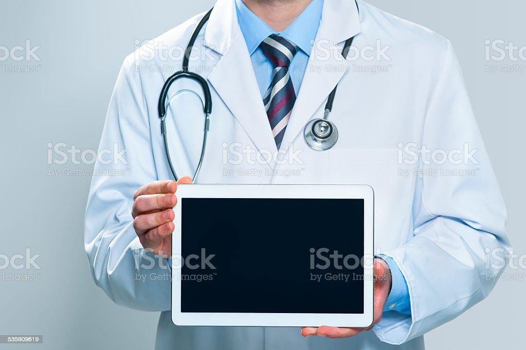 Doctor holding blank digital tablet stock photo