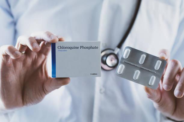Doctor holding Chloroquine Phosphate drug stock photo