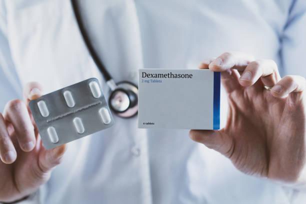 Doctor holding Dexamethasone steroid drug stock photo