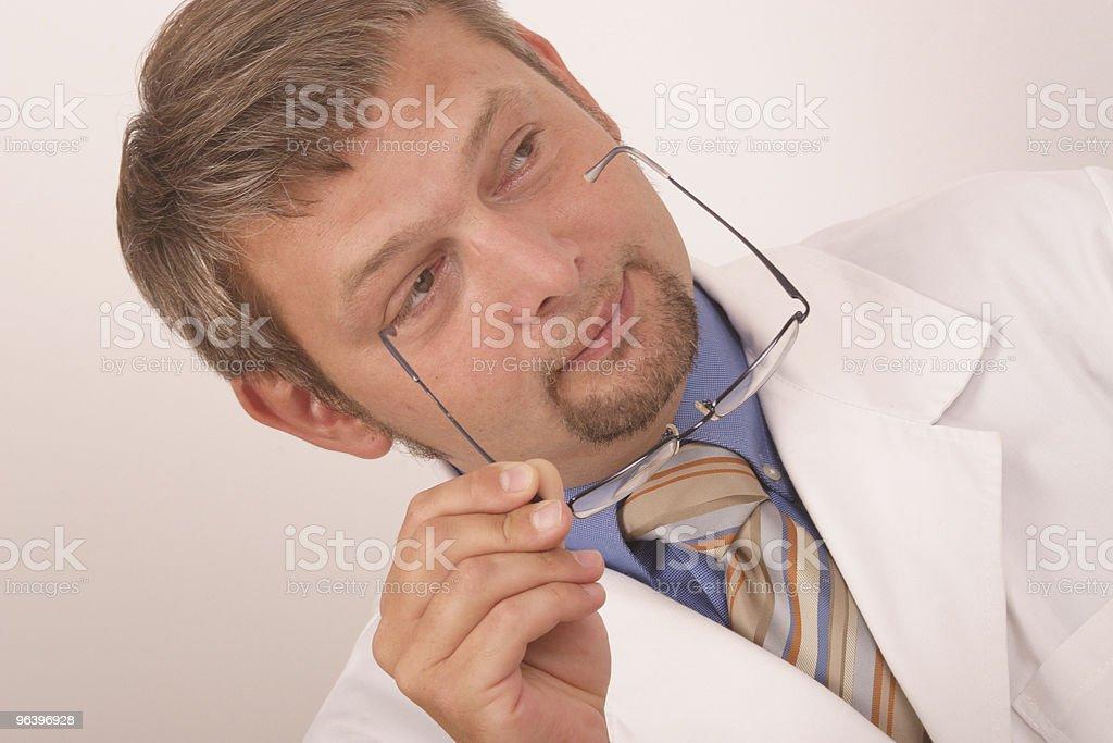 Doctor holding eyeglasses - Royalty-free Adult Stock Photo