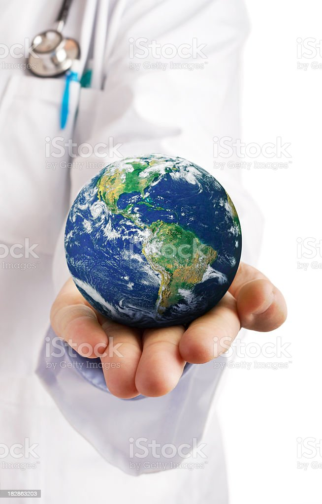 Doctor holding globe in their palm stock photo