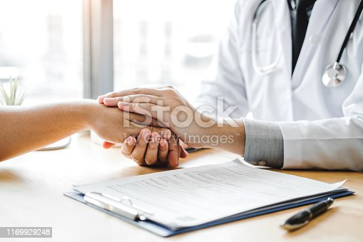 istock Doctor holding hands for comforting and care patient hospital and medicine concept 1169929248