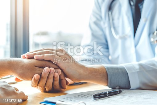 istock Doctor holding hands for comforting and care patient 1134372185