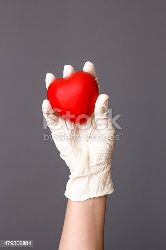 1035479448 istock photo Doctor Holding Heart 479306884