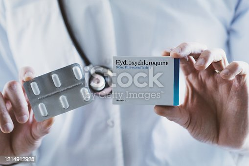 Doctor holding Hydroxychloroquine drug