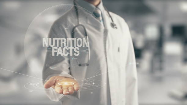 Doctor holding in hand Nutrition Facts stock photo