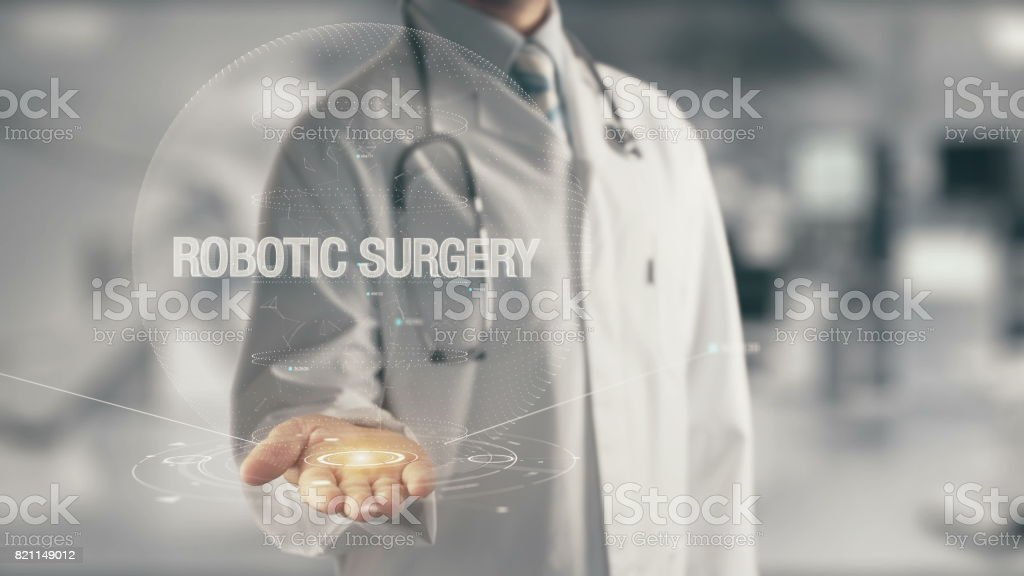 Doctor holding in hand Robotic Surgery stock photo