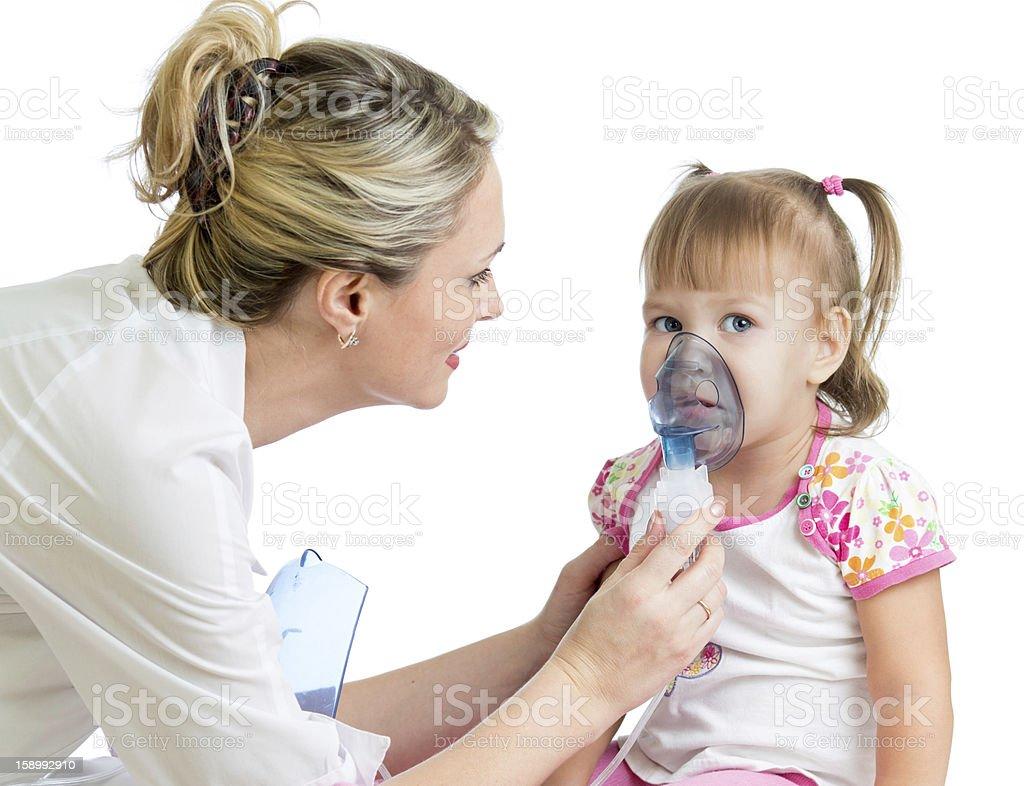 Doctor holding inhaler mask for kid girl breathing stock photo