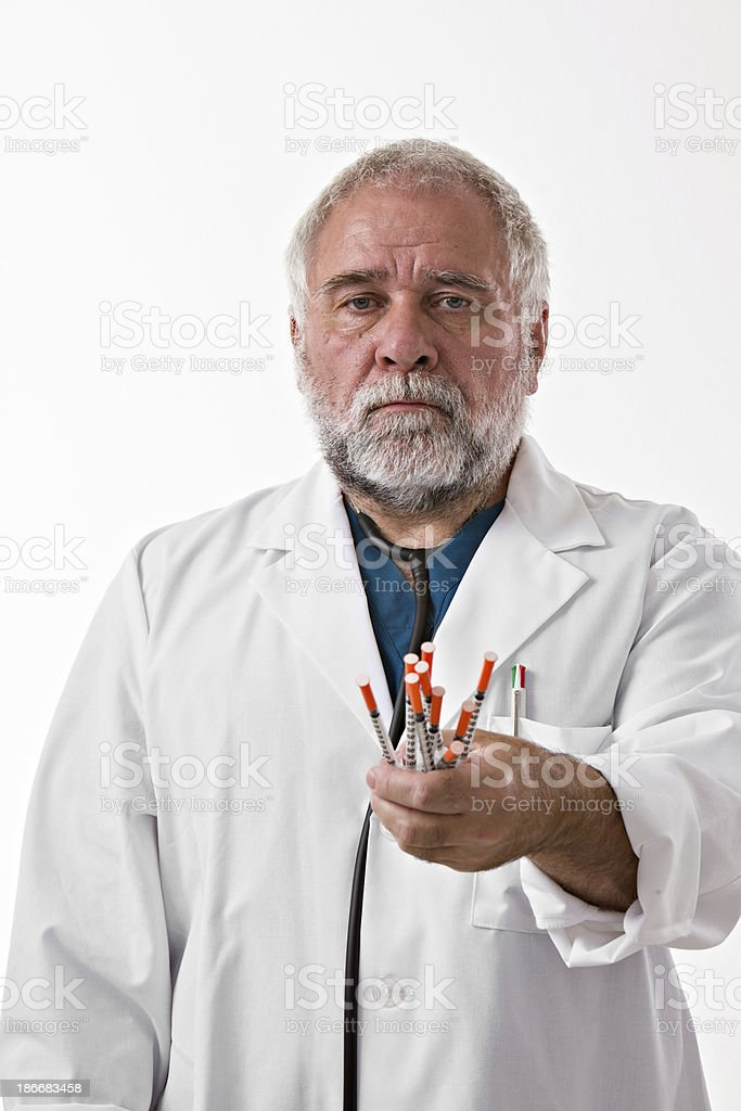 Doctor Holding Insulin Syringes stock photo