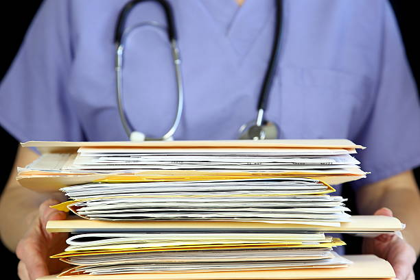 Doctor holding Medical Files stock photo