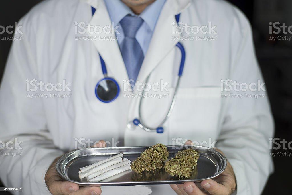 Doctor holding medical marijuana stock photo