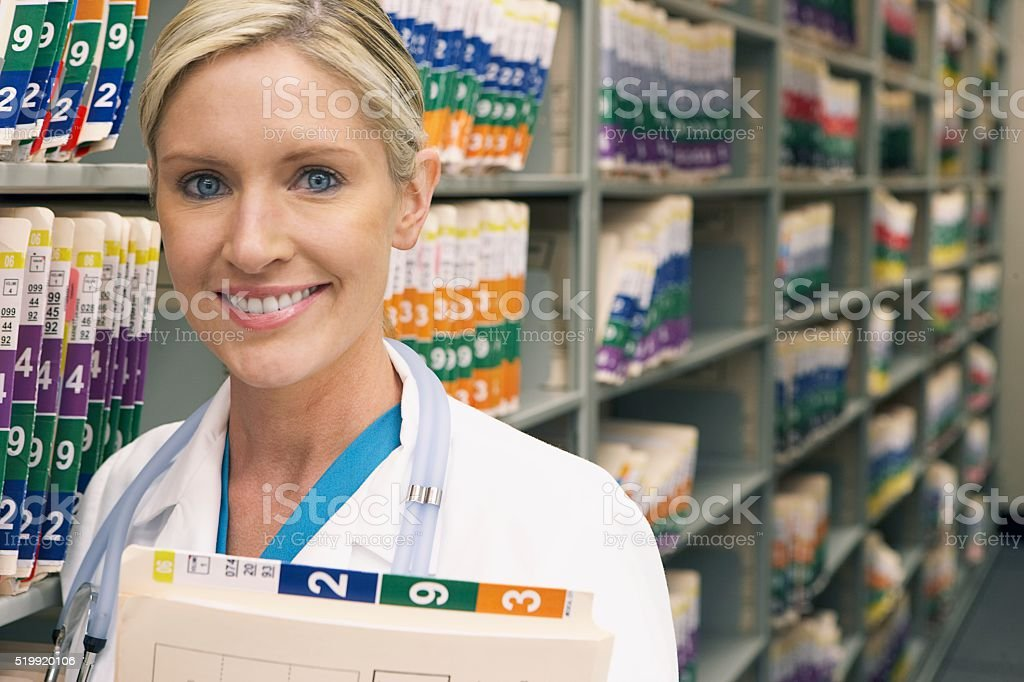 Doctor holding medical records stock photo