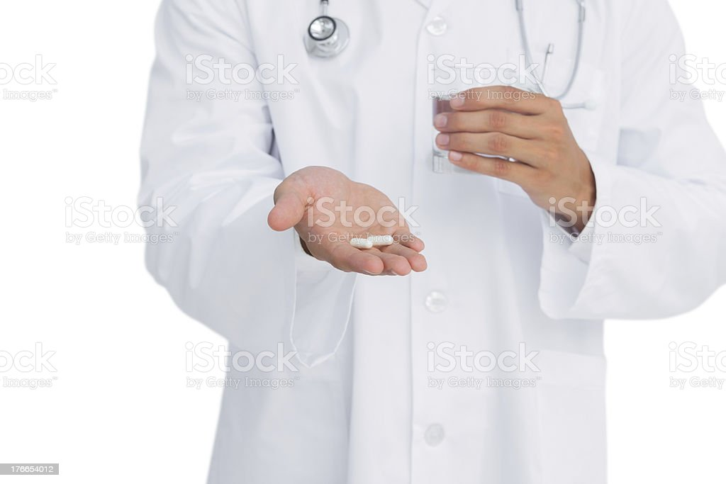 Doctor holding medicine and glass of water royalty-free stock photo