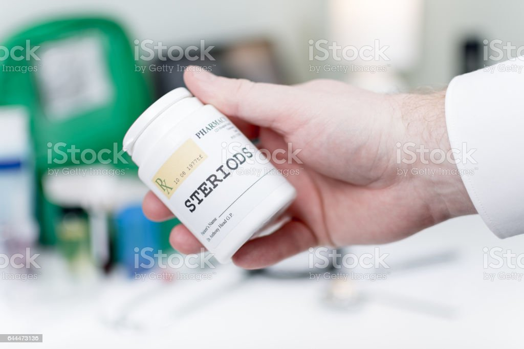 Doctor holding medicine - steroids stock photo