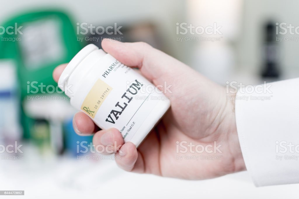 Doctor holding medicine - Valium stock photo