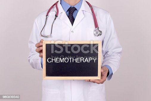 646435702istockphoto Doctor holding mini blackboard with CHEMOTHERAPY message 980839340
