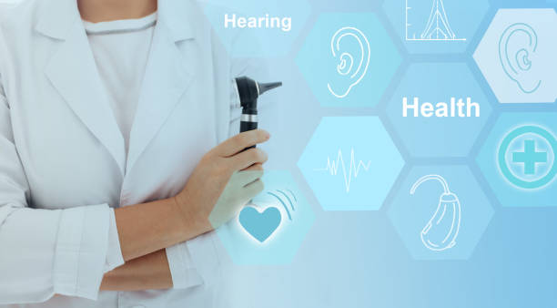 doctor holding otoscope with hearing icons flow on virtual screen.concept illustrates future technologies for the treatment of hearing - hearing loss stock pictures, royalty-free photos & images