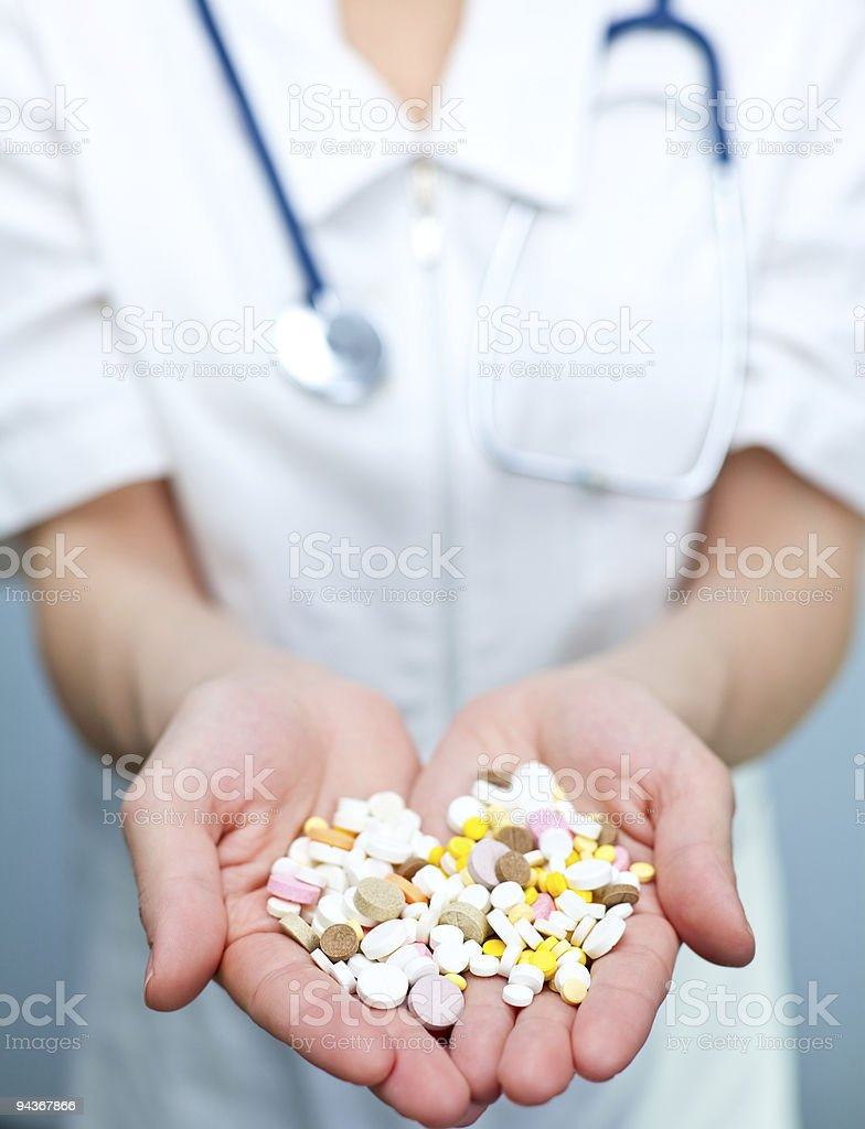 Doctor holding pills royalty-free stock photo