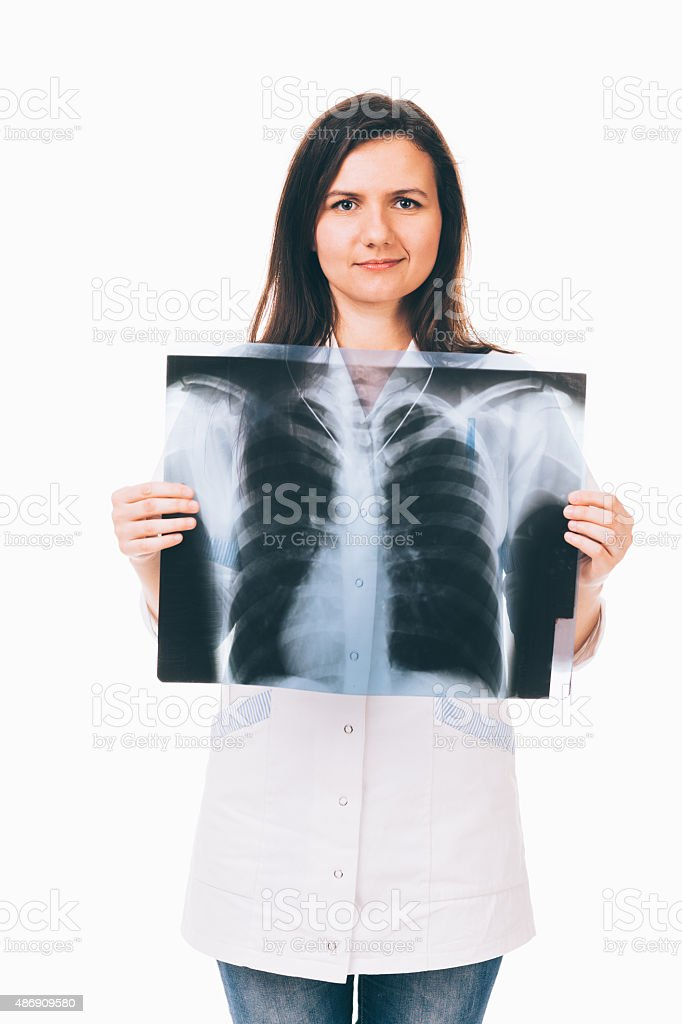 Doctor holding radiography in front of chest stock photo