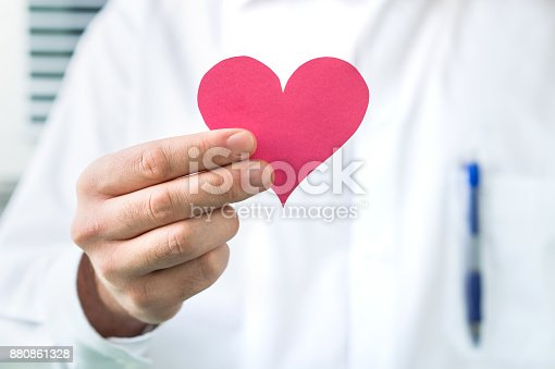 istock Doctor holding red heart. 880861328
