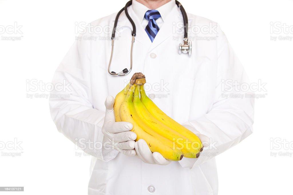 Doctor Holding Ripe Bananas stock photo