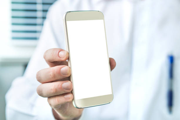 doctor holding smartphone with empty blank white screen. medical professional, physician, nurse or dentist showing mobile phone. - hand holding phone zdjęcia i obrazy z banku zdjęć