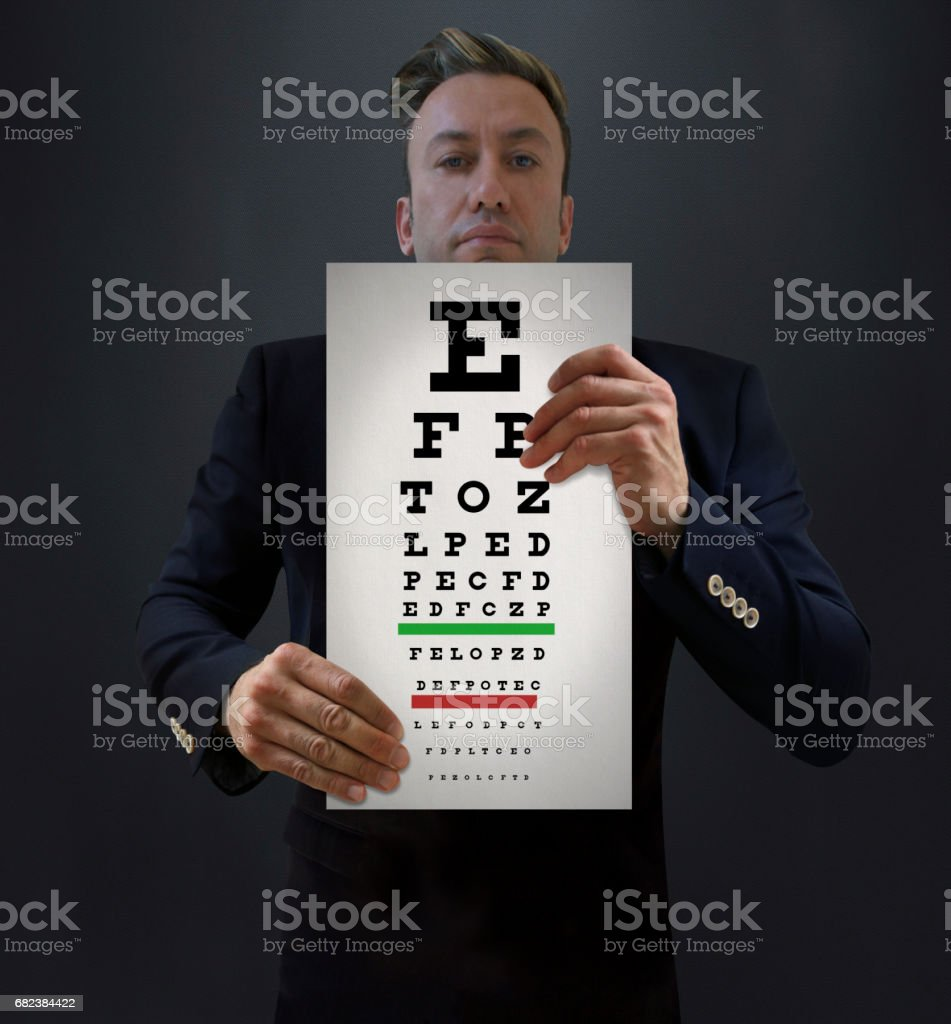 Doctor Holding Snellen Chart royalty-free stock photo