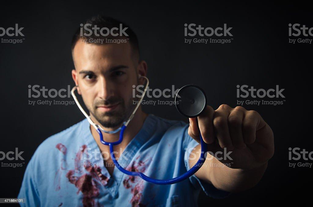 Doctor holding stethoscope royalty-free stock photo