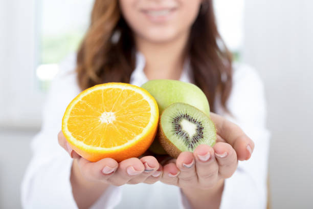 Doctor holds some fruits stock photo