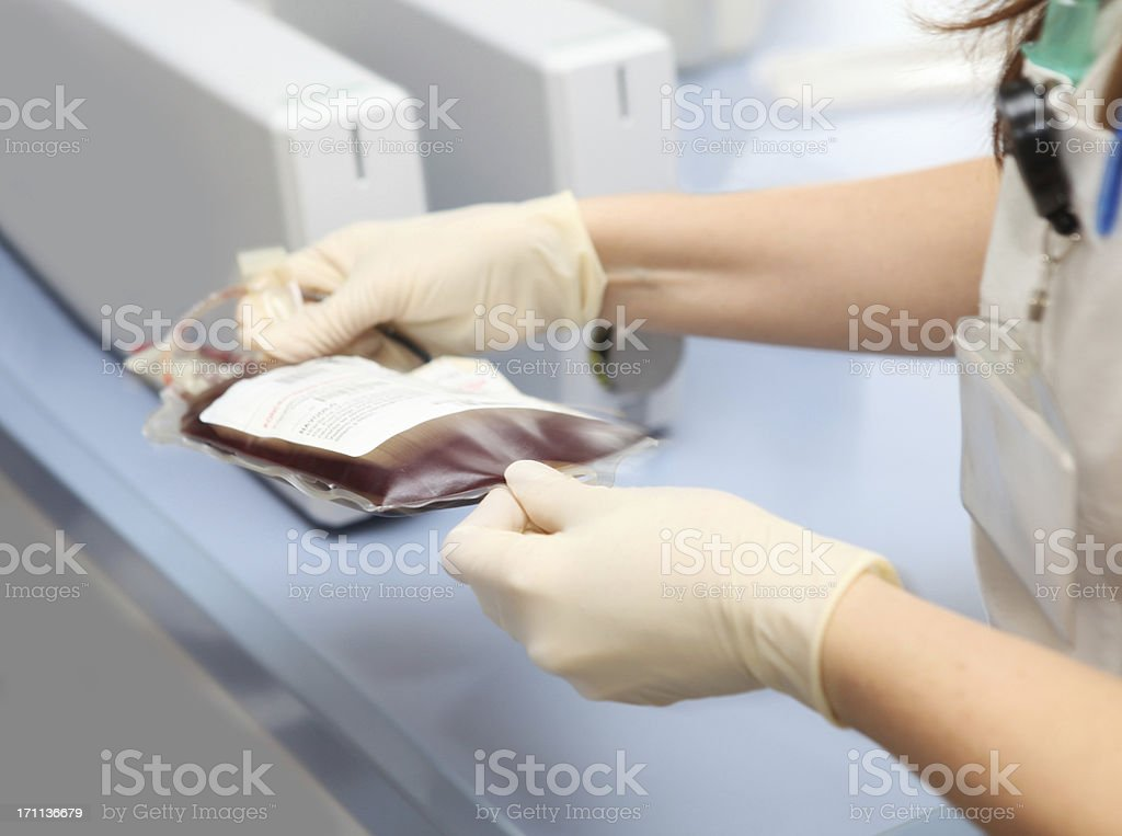 Doctor in a blood bank holding  bag  with red cells royalty-free stock photo