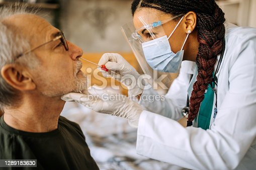 istock Doctor in a home visit to a senior man 1289183630